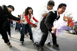 Wheeled wedding rolls through Beijing