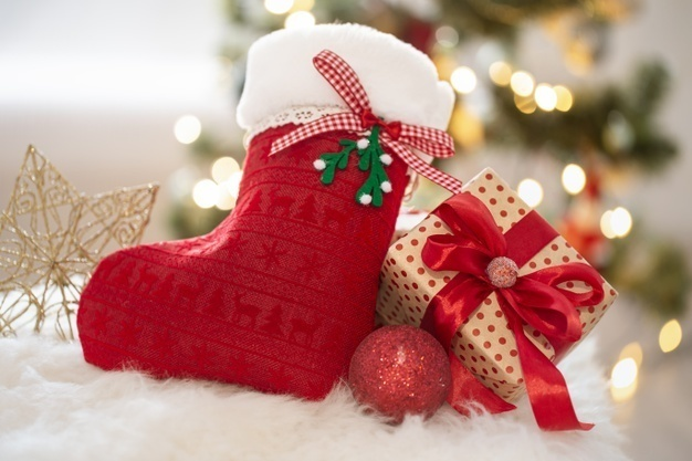 new-year-holiday-background-with-a-decorative-sock-and-gift-box-in-a-cozy-home-atmosphere-close-up_169016-6603.jpg