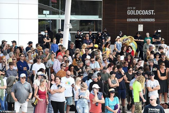 47307833-9942045-Hundreds_gathered_together_outside_the_Gold_Coast_Council_Chambe-a-89_1630395637136.jpg