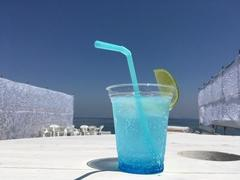 Blue soda water on the white terrace