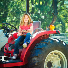 GIRL ON TRACTOR